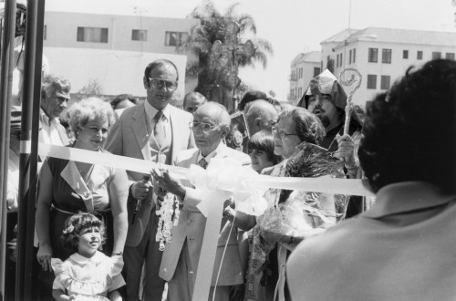 Photo of archbishop Vatche Hovespian, school founder Mr. Arshag Dickranian cutting the ribbon along with his wife Mrs. Eleanor Dickranian and school board chairman Mr. George Mandossian